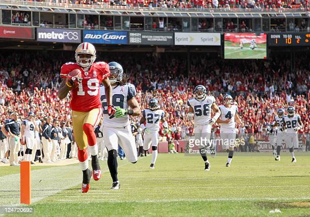 Ted Ginn of the San Francisco 49ers outruns Earl Thomas and the rest of the Seattle Seahawks on his way to scoring a touchdown on a kickoff return...