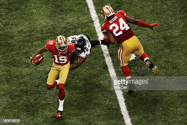 Ted Ginn of the San Francisco 49ers returns a punt 32 yards in the third quarter against Albert McClellan of the Baltimore Ravens during Super Bowl...