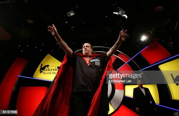 Ted Hankey of England enters the stage before beating Brian Woods of England during the Lakeside World Darts Championships 1st Round match at...