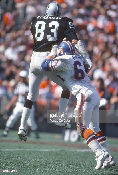 Ted Hendricks of the Oakland Raiders gets blocked by Bill Bryan of the Denver Broncos during an NFL football game December 3 1978 at the...