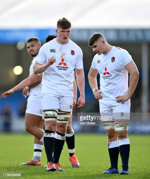 Ted Hill of England speaks with Aaron Hinkley of England during the Under 20 Six Nations match between England and France at Sandy Park on February...