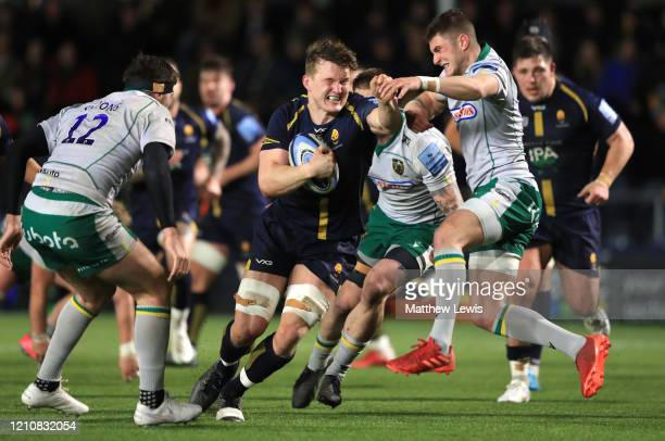 Ted Hill of Worcester Warriors is tackled by James Grayson of Northampton Saints during the Gallagher Premiership Rugby match between Worcester...