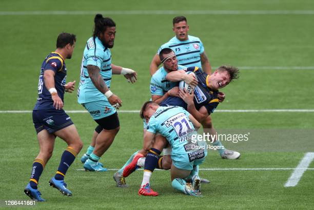 Ted Hill of Worcester Warriors is tackled by Stephen Varney and Lewis Ludlow of Gloucester Rugby during the Gallagher Premiership Rugby match between...