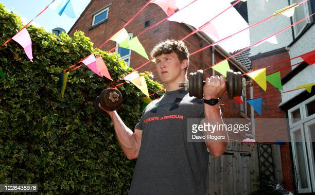 Ted Hill, the Worcester Warriors flank forward, works out at home during the coronavirus pandemic on May 22, 2020 in Worcester, England. The...