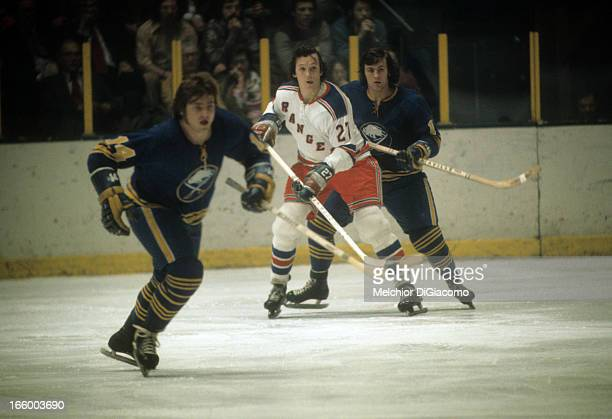 Ted Irvine of the New York Rangers battles for position during an NHL game against the Buffalo Sabres circa 1972 at the Madison Square Garden in New...