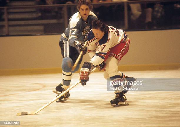 Ted Irvine of the New York Rangers battles for the puck with Joe Noris of the Pittsburgh Penguins circa 1972 at the Madison Square Garden in New York...