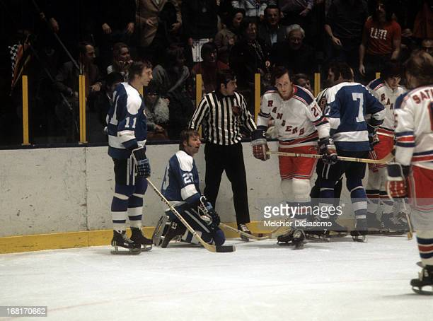 Ted Irvine of the New York Rangers skates away from Nick Harbaruk Eddie Shack and Bryan Hextall of the Pittsburgh Penguins circa 1973 at the Madison...