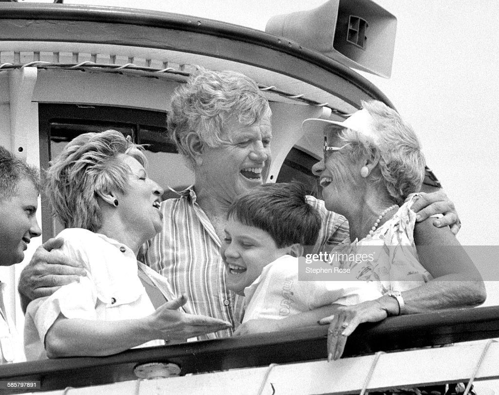 Ted Kennedy greets friends before a boat ride around Hyannis Port Harbor, Massachusetts, during a clambake at the Kennedy Compound, 5th August 1989.