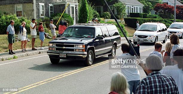 Ted Kennedy's Suburban leads a pair of vans carrying members of the Kennedy and Bessette families into Woods Hole MA where the families boarded a...