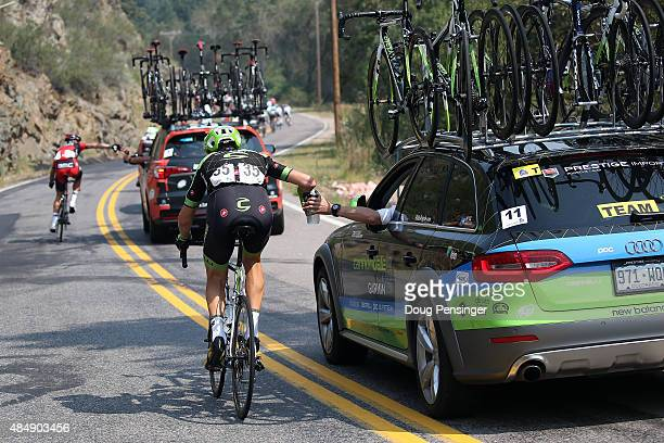 Ted King of the United States riding for Cannondale-Garmin collects drinks from the team car for his teammates during stage six of the 2015 USA Pro...