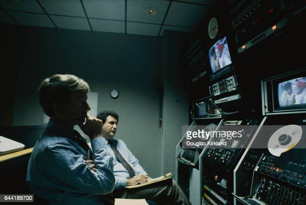 Ted Koppel Watching News Footage
