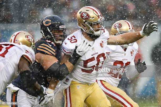 Ted Larsen of the Chicago Bears holds back Nick Bellore of the San Francisco 49ers in the first quarter at Soldier Field on December 4, 2016 in...