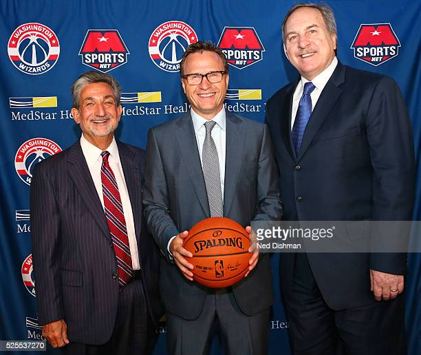 Ted Leonsis the Owner CEO of Monumental Sports Entertainment and Ernie Grunfeld GM of the Washington Wizards pose for a photo with the Washington...