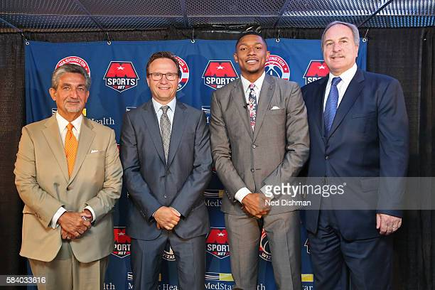 Ted Leonsis the Owner CEO of Monumental Sports Entertainment Ernie Grunfeld GM of the Washington Wizards Bradley Beal and Scott Brookpose for a photo...