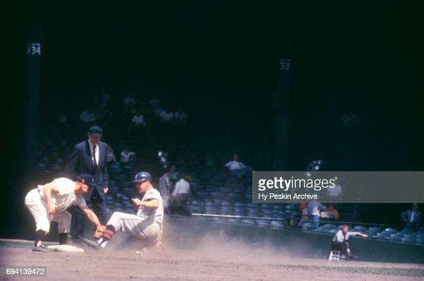 Ted Lepcio of the Detroit Tigers puts the tag on Hal Smith of the Kansas City Athletics as umpire Eddie Rommel is there to make the call during an...
