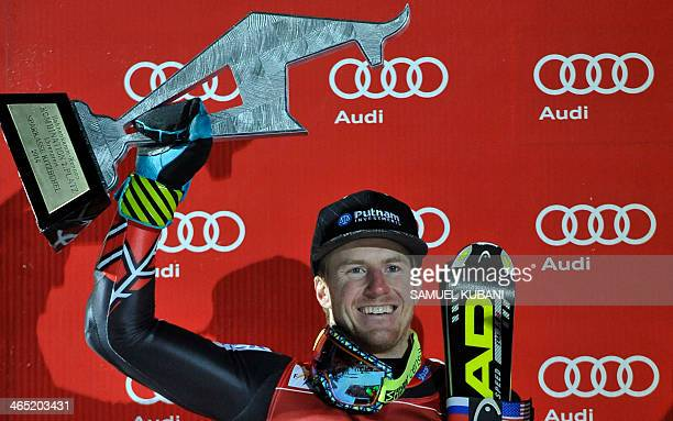 US Ted Ligety celebrates on podium his second place after competing on January 26 2014 in the FIS men's Alpine ski World Cup Super Combined race in...