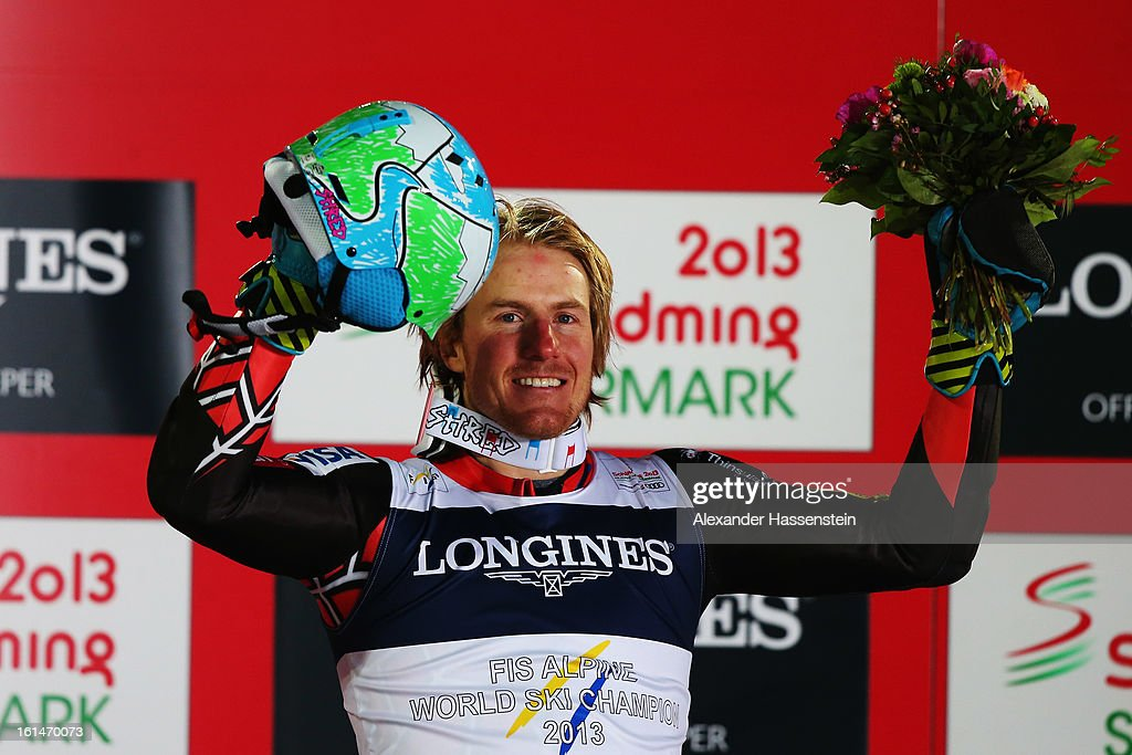 Ted Ligety of the United States of America celebrates at the flower ceremony after winning the Men's Super Combined during the Alpine FIS Ski World Championships on February 11, 2013 in Schladming, Austria.