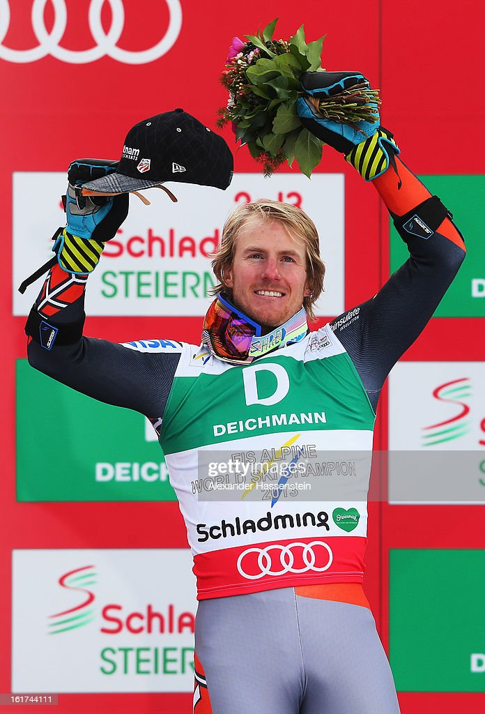 Ted Ligety of the United States of America celebrates at the flower ceremony after winning the Men's Giant Slalom during the Alpine FIS Ski World Championships on February 15, 2013 in Schladming, Austria.