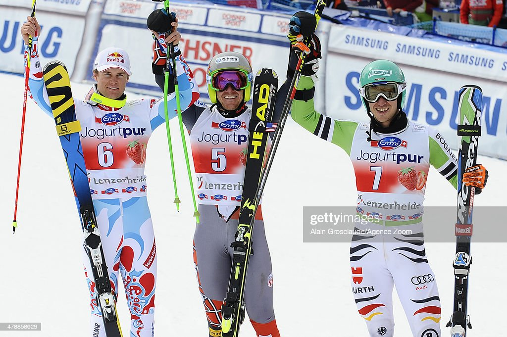 Ted Ligety of the USA takes 1st place and wins the overall giant slalom World Cup globe, Alexis Pinturault of France takes 2nd place and is third in the overall giant slalom World Cup, Felix Neureuther of Germany takes 3rd place during the Audi FIS Alpine Ski World Cup Finals Men's Giant Slalom on March 15, 2014 in Lenzerheide, Switzerland.