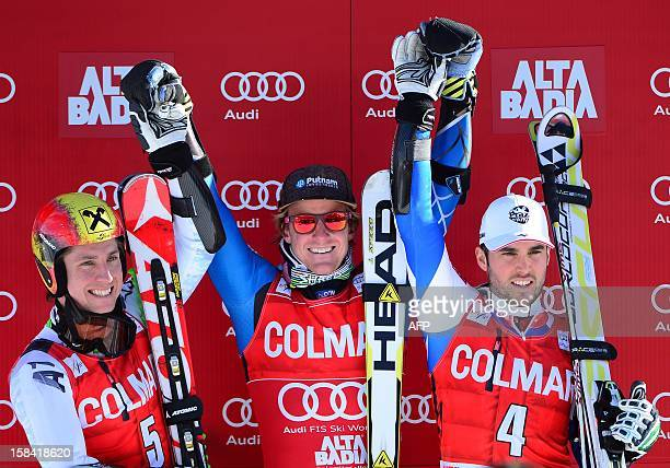 Ted Ligety of the USA , who came in first, celebrates alongside second place winner Marcel Hirscher of Austria , and third place winner Thomas Fanara...