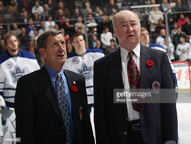 Ted Lindsay and Red Kelly sign along with the national anthem prior to the game between the Toronto Maple Leafs and the Buffalo Sabres at the Air...
