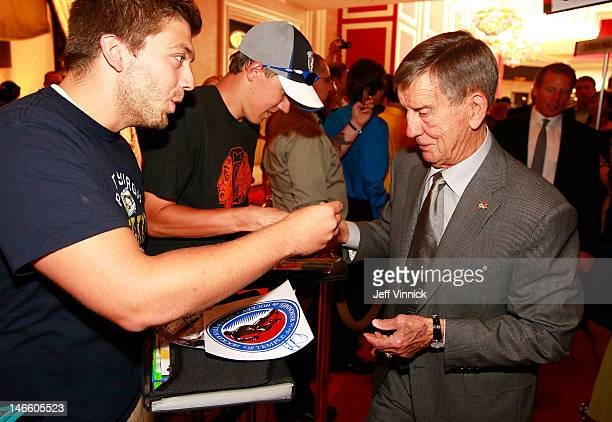 Ted Lindsay signs an autograph as he arrives before the 2012 NHL Awards at the Encore Theater at the Wynn Las Vegas on June 20 2012 in Las Vegas...