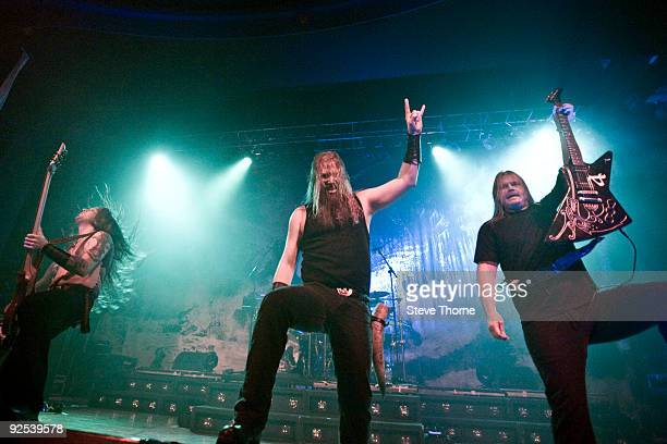 Ted Lundstrom Johan Hegg and Olavi Mikkonen of Amon Amarth perform on stage at Wulfrun Hall on October 28 2009 in Wolverhampton England