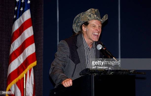 Ted Nugent a member of the National Rifle Association board of directors and an avid hunter delivers a speech to conventioneers entitled God Guns and...