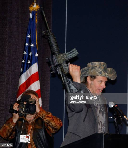 Ted Nugent a member of the National Rifle Association board of directors and an avid hunter holds up an assault rifle while delivering a speech to...