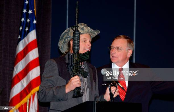 Ted Nugent a member of the National Rifle Association board of directors and an avid hunter talks with NRA President Kayne Robinson before delivering...
