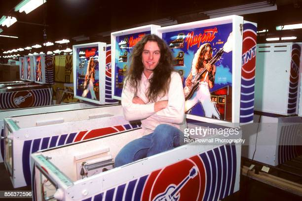 Ted Nugent sits in a new 'Nugent' pinball machine on the assemblyline at the Stern Electronics manufacturing plant in Chicago IL November 29 1978