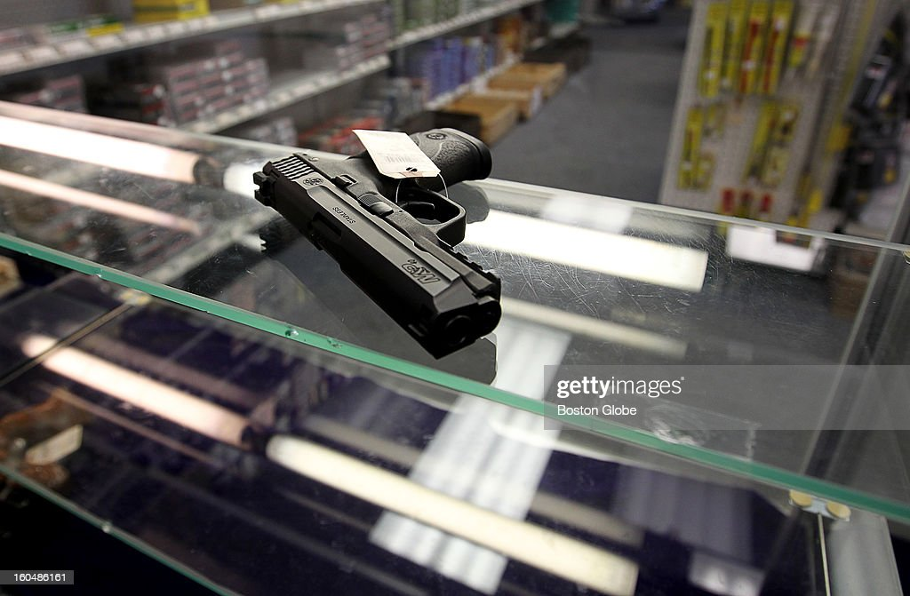 Ted Oven, owner of Northeast Trading Co., Inc., has had a hard time keeping guns in stock because of the skyrocketing demand. A lone Smith & Wesson M&P hand gun sits on a shelf in a display case awaiting a buyer.