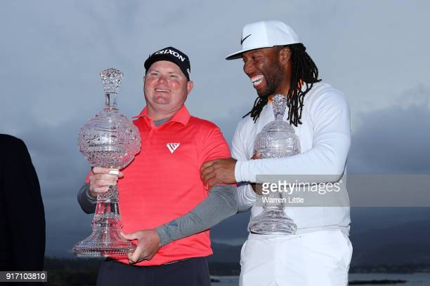 Ted Potter Jr and Larry Fitzgerald celebrate after winning the ATT Pebble Beach ProAm at Pebble Beach Golf Links on February 11 2018 in Pebble Beach...