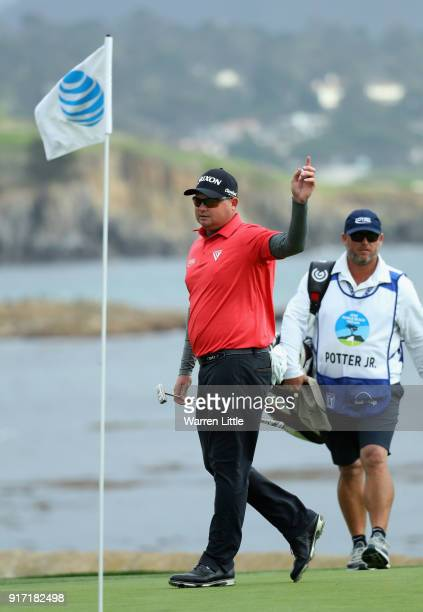 Ted Potter Jr of the USA acknowledges the crowd on the 18th green during the final round of the ATT Pebble Beach ProAm the Pebble Beach Golf Links on...