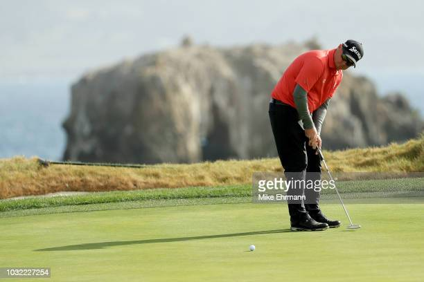 Ted Potter Jr putts on the 17th green during the Final Round of the ATT Pebble Beach ProAm at Pebble Beach Golf Links on February 11 2018 in Pebble...