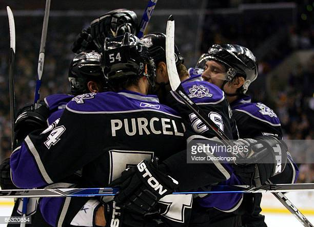 Ted Purcell Michal Handzus and Alexander Frolov of the Los Angeles Kings celebrate with teammate Jarret Stoll after Stoll's goal in the second period...