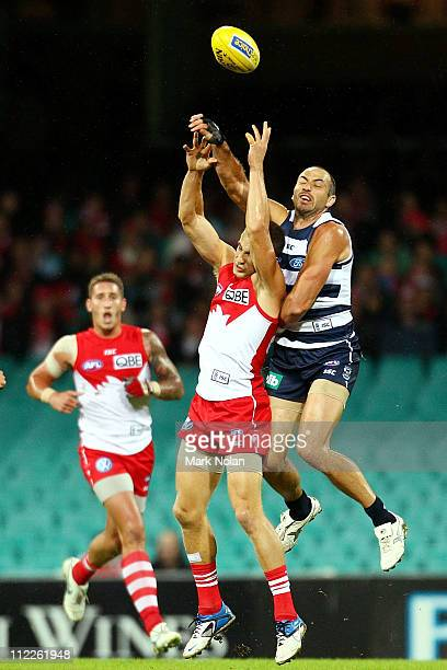 Ted Richards of the Swans and James Podsiadly of the Cats contest possession during the round four AFL match between the Sydney Swans and the Geelong...