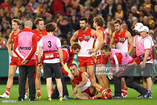 Ted Richards of the Swans is attended to by trainers after getting a concussion during the round nine AFL match between the Hawthorn Hawks and the...