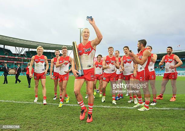Ted Richards of the Swans is clapped off the field after receiving a trophy for player of the match during the round five AFL match between the...