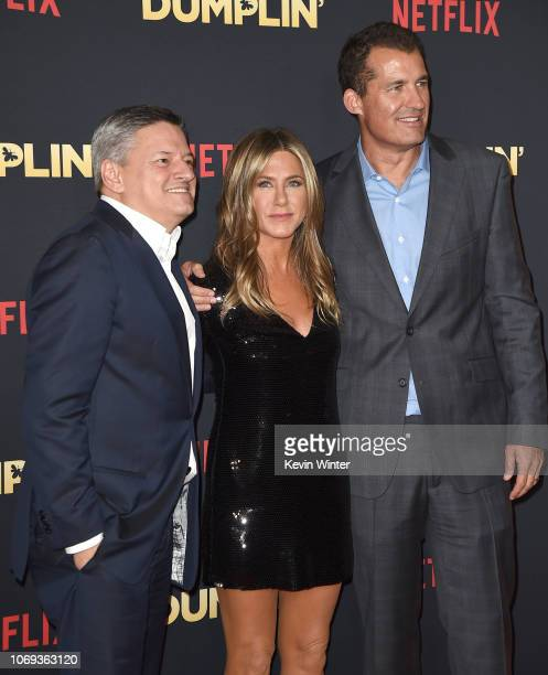 Ted Sarandos Jennifer Aniston and Scott Stuber arrive at the premiere of Netflix's 'Dumplin'' at the Chinese Theater on December 6 2018 in Los...