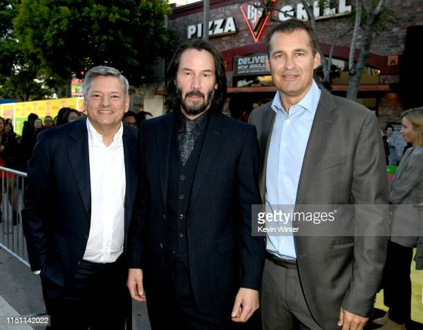 Ted Sarandos Keanu Reeves and Scott Stuber arrive at the premiere of Netflix's Always Be My Maybe at the Regency Village Theatre on May 22 2019 in...