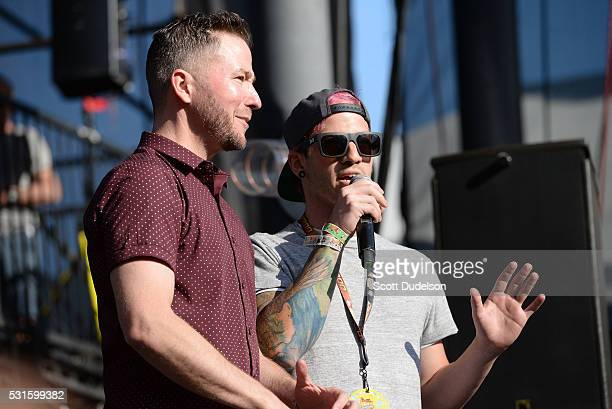 Ted Stryker of KROQ and Josh Dun of the band Twenty One Pilots introduce a band onstage during KROQ's Weenie Roast at Irvine Meadows Amphitheatre on...