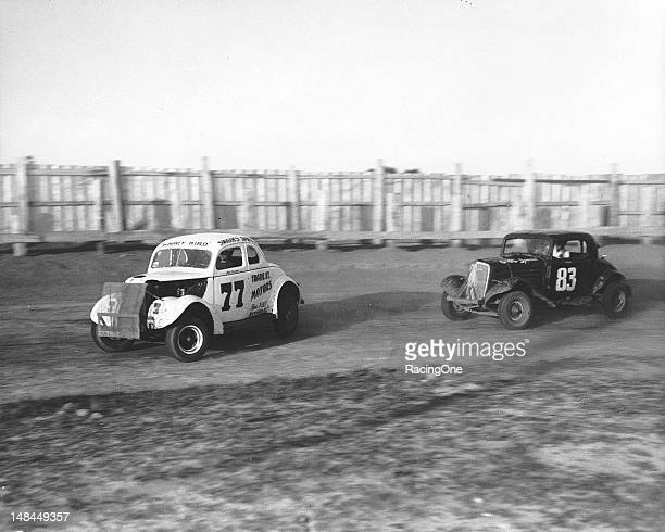 "Ted Swaim of High Point NC keeps his ""Gooney Bird"" Modified stock car ahead of a fellow competitor during a race at Greensboro Fairgrounds"
