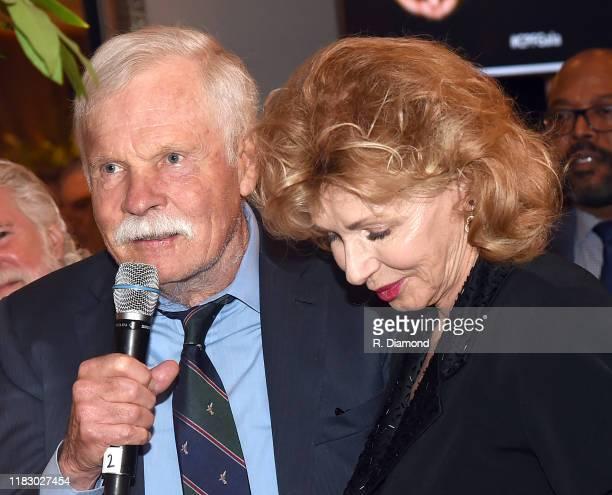 Ted Turner and Girl Friend Sally Rainey attend 2019 Captain Planet Foundation Gala at Flourish Atlanta on November 16 2019 in Atlanta Georgia