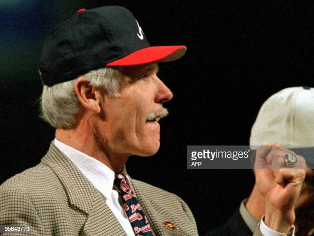 Ted Turner owner of the Atlanta Braves looks at his new National League ring presented to him and the rest of the Atlanta Braves before the beginning...