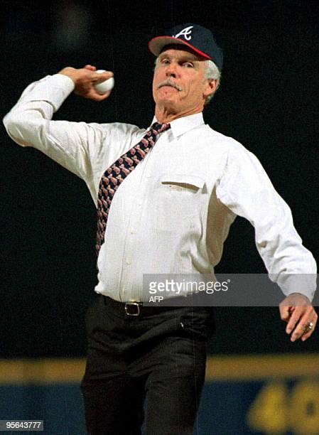 Ted Turner owner of the Atlanta Braves throws the first pitch before the first regular season game in the Braves new stadium Turner Field 04 April...