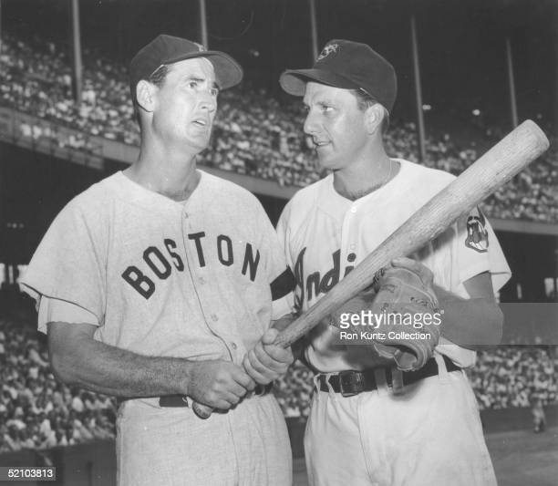 Ted Williams of the Boston Red Sox and Ralph Kiner of the Cleveland Indians pose together prior to a 1955 season game at Municipal Stadium in...