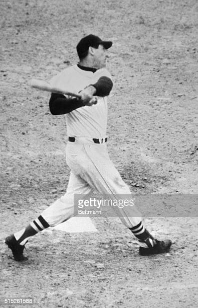 Ted Williams of the Boston Red Sox clouts his 521st home run before he announced that he had played his last game the 420 foot drive came in the...