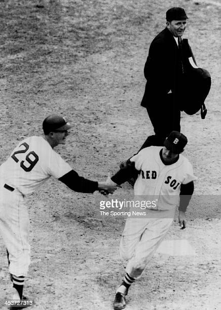 Ted Williams of the Boston Red Sox crosses home plate to score on the final home run of his career on Sept 28, 1960 in Boston, Massachusetts.