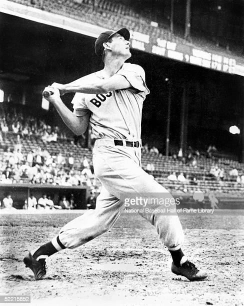 Ted Williams of the Boston Red Sox swings during a game Teddy Samuel Williams played for the Red Sox from 19391960